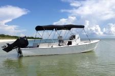 Dual 3-Bow Round Tube Bimini Tops on a 1970 Proline Pro 24 Boat.