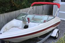 2002 caravelle 186 Boat - Bimini Top Folded  on Brace Kit - A3687UB-20 Logo Red
